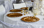 Wedding decorator table set with copper plates.