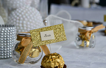 Wedding Decorator Bride event photo with white and chrome accents on a table